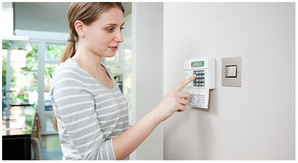Woman checking alarm